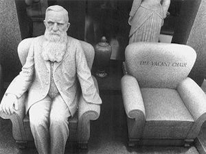 Man-In-Chair Grave Marker